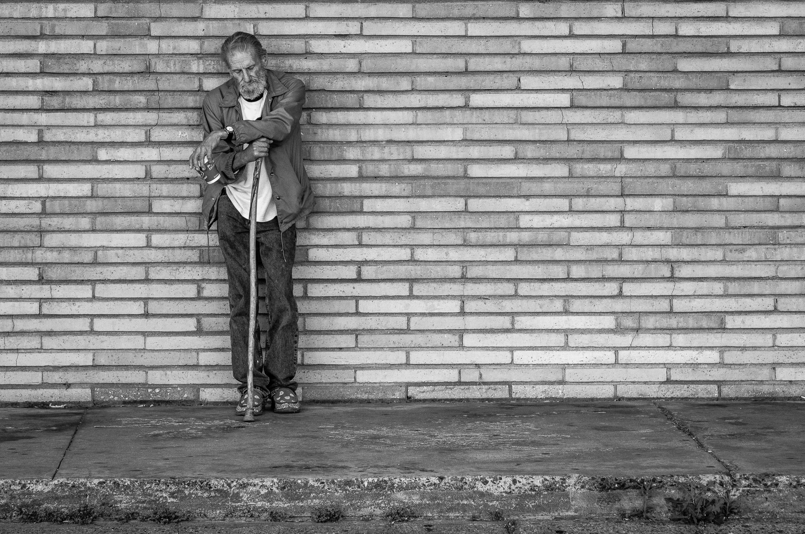 A Homeless Man Waits